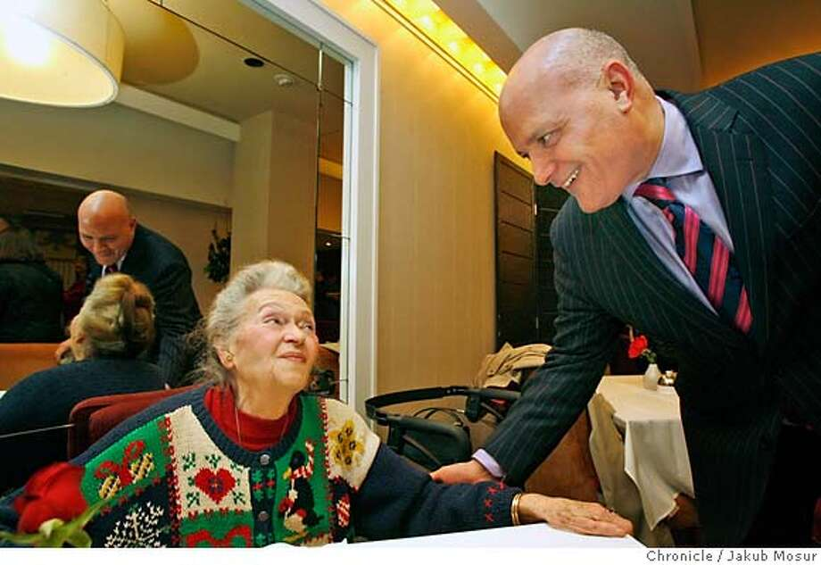 ".JPG  Edith Marsh, a long time I.Magnin employee, talks with John Capizzi, VP and general manager at Neiman Marcus, at the launch party for ""A Store to Remember"" book by James Thomas Mullane about the history of the now-defunct, but once great I. Magnin department store. The party took part in the Rotunda restaurant at the Neiman Marcus Department store at Union Square.  Event on 12/21/06 in San Francisco. JAKUB MOSUR / The Chronicle MANDATORY CREDIT FOR PHOTOG AND SF CHRONICLE/ -MAGS OUT Photo: JAKUB MOSUR"