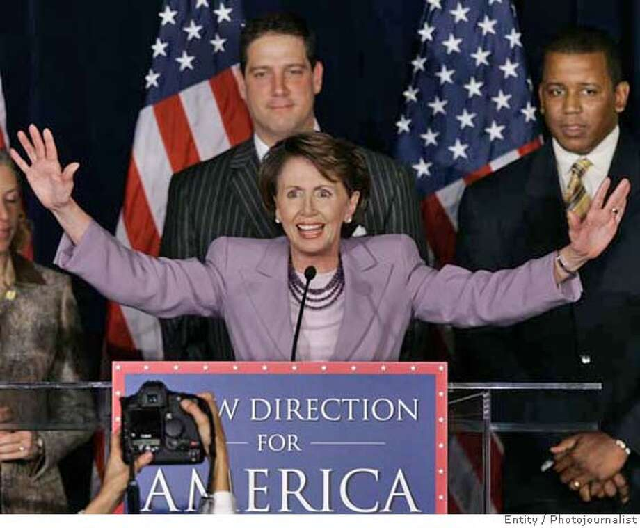 House Democratic Leader Rep. Nancy Pelosi, D-Calif., fires up fellow Democrats at an election night rally at the Hyatt Regency Hotel near the Capitol in Washington Tuesday, Nov. 7, 2006. She is joined, left to right, by Rep. Tim Ryan, D-Ohio, and Rep. Kendrick Meek, D-Fla. (AP Photo/J. Scott Applewhite)  Ran on: 11-09-2006  Reaching out: Rep. Nancy Pelosi wasted no time in sending signals that she wants to lead an ethical, bipartisan House of Representatives. Photo: J. SCOTT APPLEWHITE