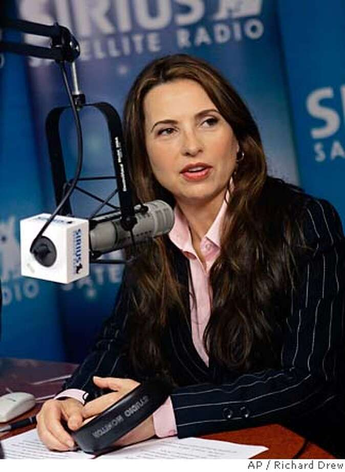 "**FILE** O.J. Simpson book publisher Judith Regan is photographed in the studio of her ""Judith Regan Show"" on Sirius satellite radio, in New York in this Thursday night Nov. 16, 2006 file photo. A lawyer for fired publisher Judith Regan says a new witness has emerged to dispute allegations that she called four industry veterans a ""Jewish cabal"" conspiring against her. (AP Photo/Richard Drew, file) Photo: RICHARD DREW"