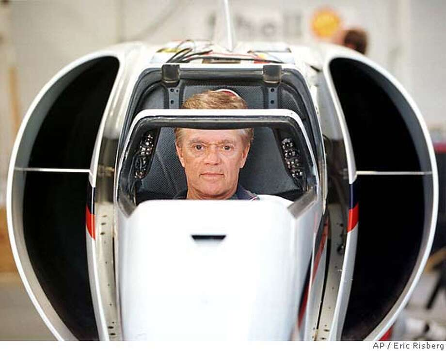 Land speed record setter Craig Breedlove, 60, sits in the confining cockpit of his $3 million rocket-powered car at his Spirit of America headquarters in Rio Vista, Calif., Wednesday Aug. 27, 1997. Breedlove is taking his car to the Black Rock Desert near Reno, Nev., and will begin time trials Sept. 6 in his attempt to set the world land speed record. Breedlove was the first to surpass 400 mph, 500 mph and 600 mph. Britain's Richard Noble will be running his rocket-powered car in the desert at the same time. (AP Photo/Eric Risberg)  Ran on: 12-31-2006  Craig Breedlove sits in the cockpit of his Spirit of America, left, in 1997. Above, the car at speed in Nevada's Black Rock Desert. Photo: ERIC RISBERG