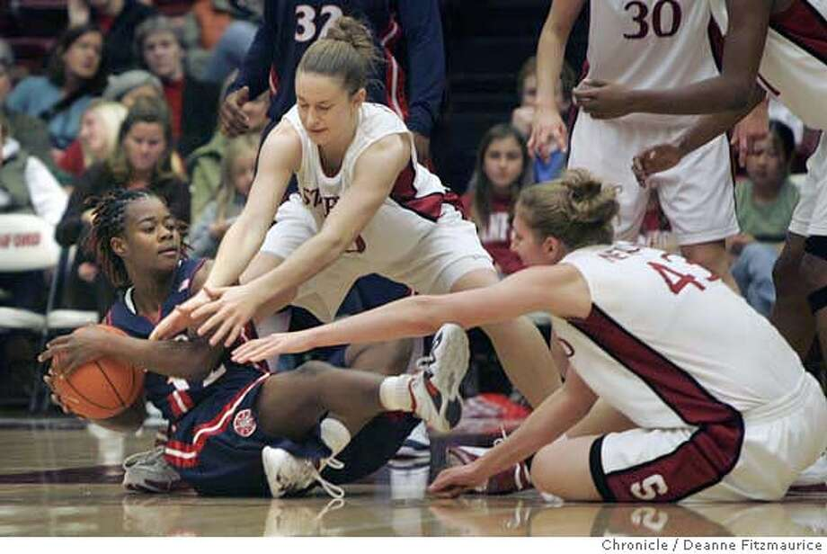 stanford_0203_df.jpg  Ashley Whisonant at left fights for the ball with #10 JJ Hones and #43 Kristen Newlin. Stanford Cardinal Women's basketball vs Arizona Wildcats at Maples Pavilion. Photographed in Stanford on 12/28/06. (Deanne Fitzmaurice/ The Chronicle) Ran on: 12-29-2006  Ashley Whisonant (left) plays keepaway with Arizona State's JJ Hones (10) and Kristen Newlin. Photo: Deanne Fitzmaurice
