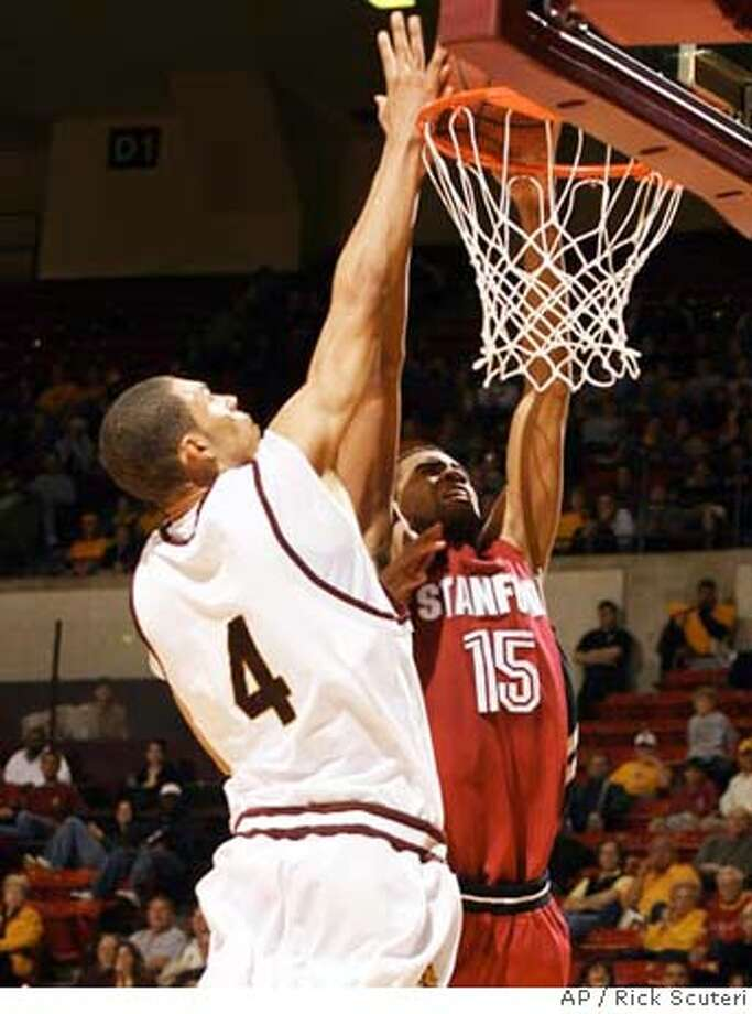 Stanford forward Lawrence Hill dunks against Arizona State forward Jeff Pendergraph during the second half of a basketball game on Thursday, Dec 28. 2006, in Tempe, Ariz. (AP Photo/Rick Scuteri) Photo: Rick Scuteri