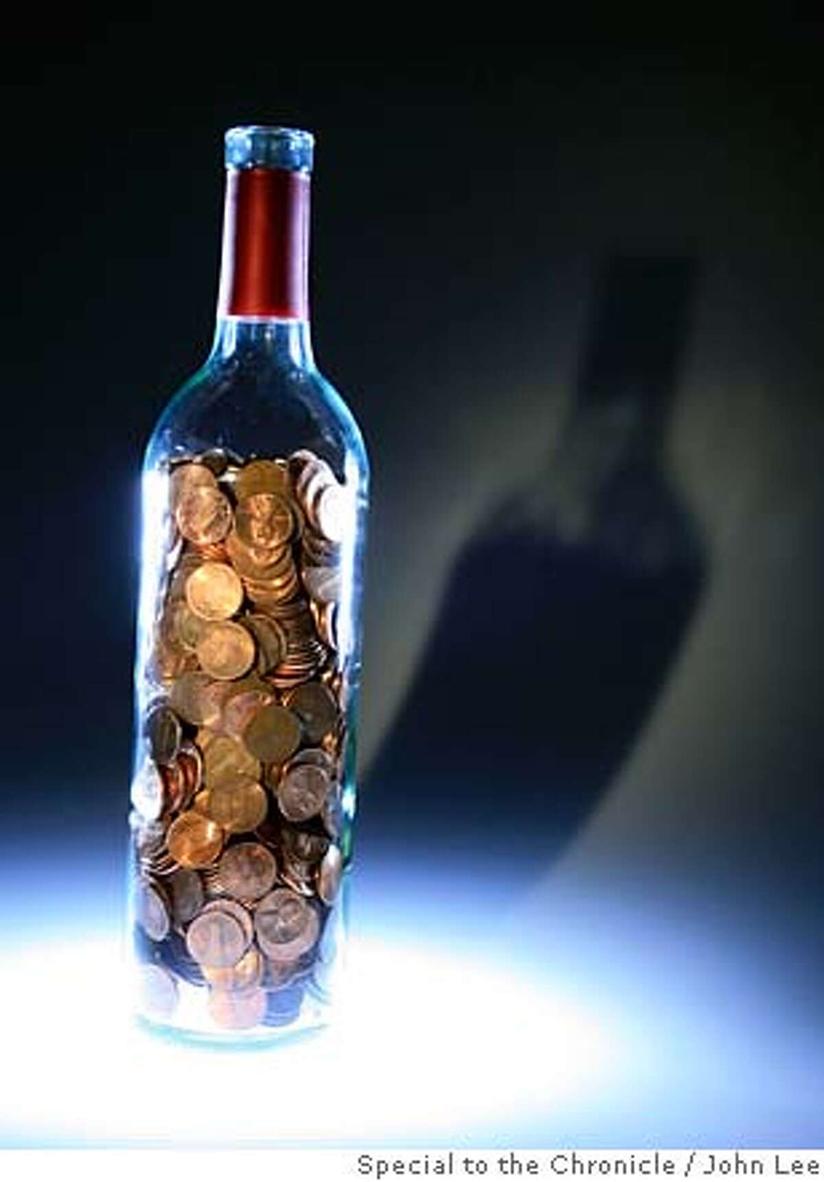 BARGAINBONANZA29_02JOHNLEE.JPG Empty wine bottle with a bunch of pennies in it. By JOHN LEE/SPECIAL TO THE CHRONICLE