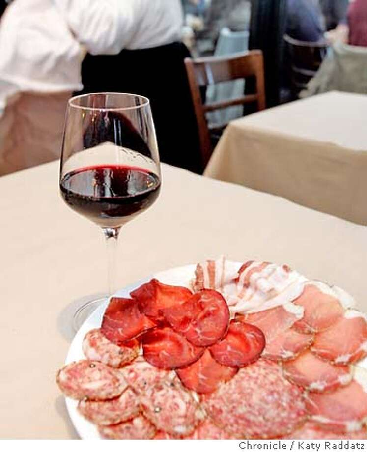 LAMBRUSCO29_028_RAD.jpg SHOWN: In a restaurant called A16, famous for its salumi, we photograph a glass of Lambrusco with a plate of salumi. This picture is for a pairings column. Wine. These photos were made on Thursday, Dec. 21, 2006, in San Francisco, CA. (Katy Raddatz/SF Chronicle)  *Lambrusco, salumi Mandatory credit for the photographer and the San Francisco Chronicle. ; mags out. Photo: Katy Raddatz