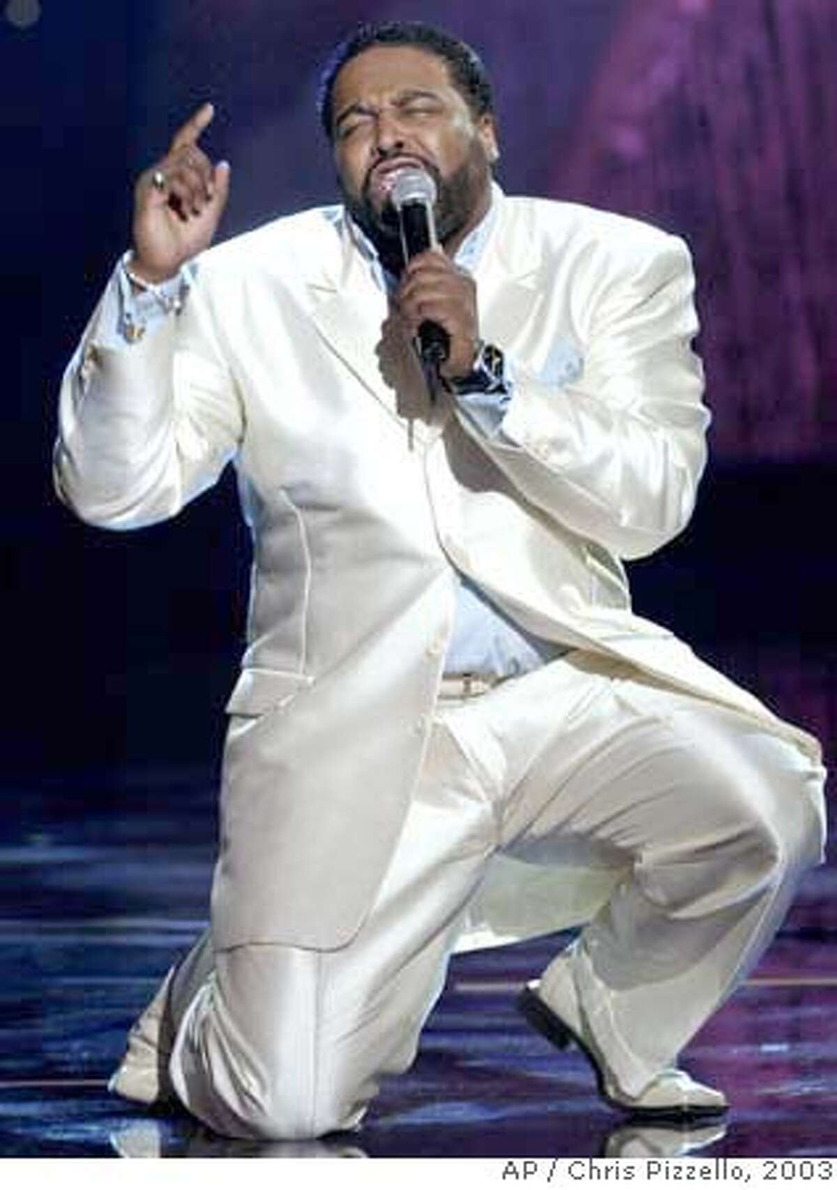 ** FILE **Gerald Levert performs during the 17th Annual Soul Train Music Awards in Pasadena, Calif., in this March 1, 2003, file photo. Levert, the fiery singer of passionate R&B love songs and the son of O'Jays singer Eddie Levert, died on Friday. He was 40. (AP Photo/Chris Pizzello/FILE) Ran on: 11-11-2006 Gerald Levert, performing at the 17th annual Soul Train Music Awards in Pasadena, was the son of OJays singer Eddie Levert. A MARCH 1, 2003 FILE PHOTO