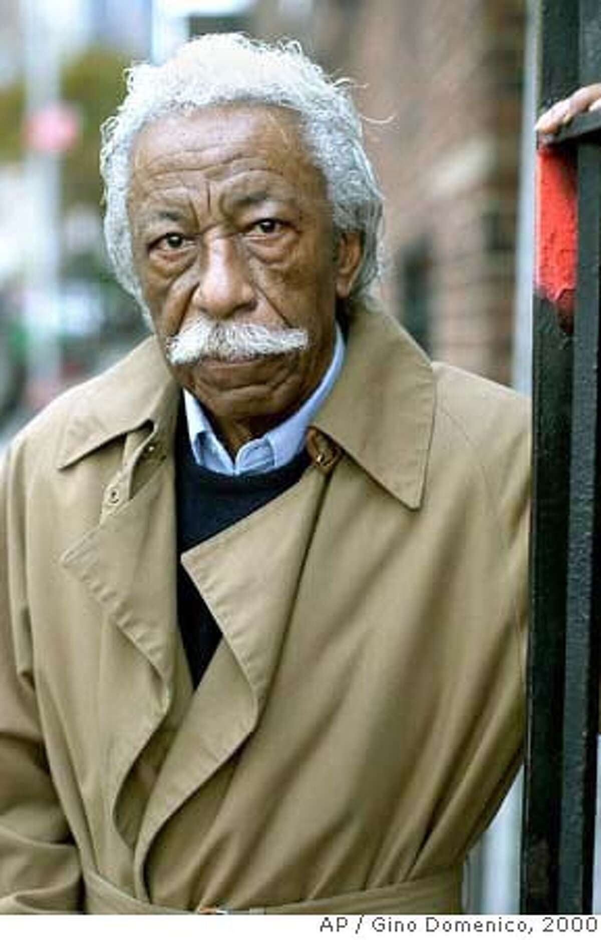 ** FILE ** Gordon Parks poses near his home in New York, in this Nov. 10, 2000 file photo. Parks, who captured the struggles and triumphs of black America as a photographer for Life magazine and then became Hollywood's first major black director with