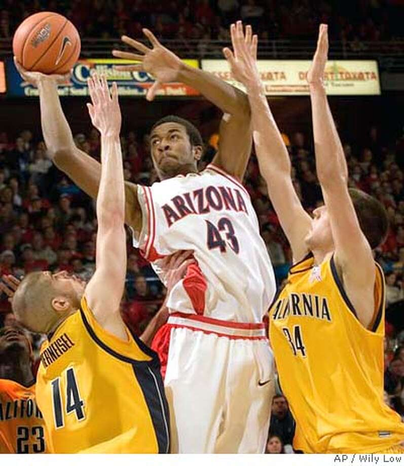 Arizona's Jordan Hill (43) drives to the basket between California's Eric Vierneisel (14) and Ryan Anderson, right, in the second half of a college basketball game on Thursday, Dec. 28, 2006, in Tucson, Ariz. Arizona won, 94 - 85. (AP Photo/ Wily Low) Photo: Wily Low