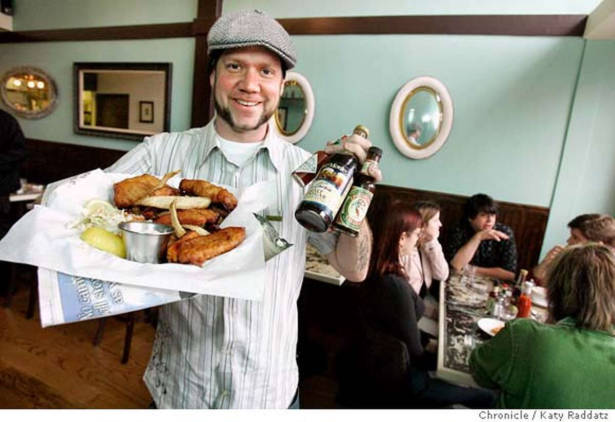 DINE15_WEIRDFISH_020_RAD.jpg SHOWN: Timothy Holt, the owner, shows off his favorite dish: Fish and Chips. The name of the restaurant is Weird Fish. It's at 2193 Mission St. in San Francisco. The decor in the restaurant was all done by Blythe Friedmann, Timothy Holt's girlfriend. These photos were made on Tuesday, Dec. 12, 2006, in San Francisco, CA. (Katy Raddatz/SF Chronicle) *TIMOTHY HOLT Ran on: 12-28-2006 Timothy Holt, owner of Weird Fish in the Mission District, displays his favorite dish, fish and chips.