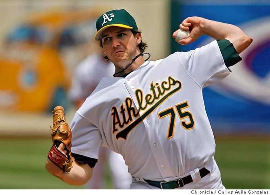 ATHLETICS03_014_CAG.JPG  Athletics starting pitcher, Barry Zito, went almost a complete game before being pulled in the top of the ninth inning. The Oakland Athletics played the Arizona Diamondbacks at McAfee Coliseum on Sunday, July 2, 2006. Oakland lost the game 3-1, as the Diamondbacks swept the series in Oakland.  Photo by Carlos Avila Gonzalez/The San Francisco Chronicle  Photo taken on 7/2/06, in Oakland, Ca, USA  **All names cq (Roster)  Ran on: 07-03-2006  Barry Zito was named to his third All-Star Game, the lone A's representative. Photo: Carlos Avila Gonzalez