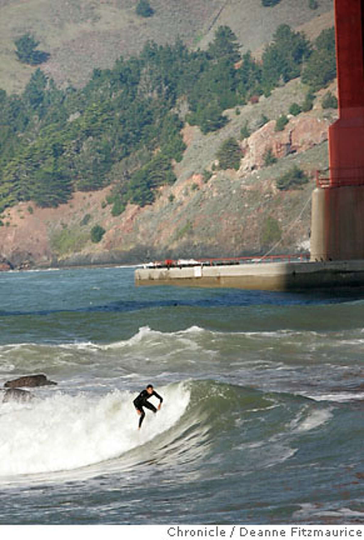 weather_001_df.jpg Surfers came to Fort Point under the Golden Gate Bridge for larger than usual waves. Photographed in San Francisco on 12/27/06. (Deanne Fitzmaurice/ The Chronicle)