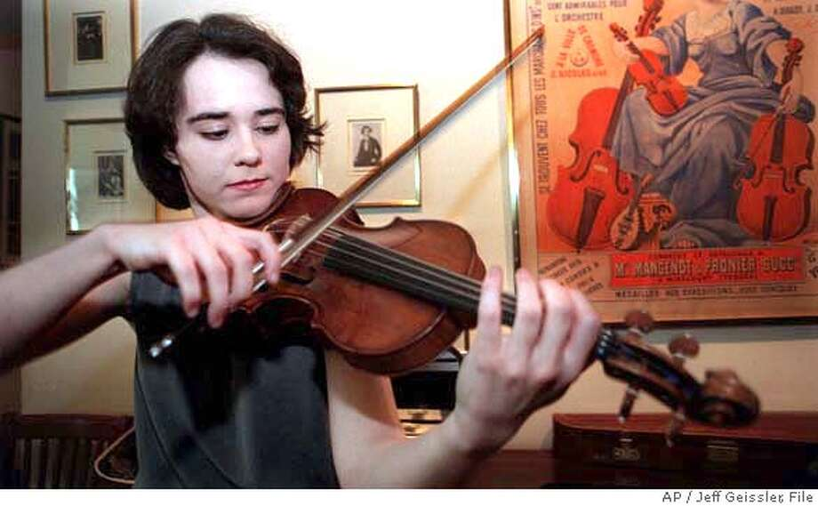 Concert violinist Judith Ingolfsson plays a1683 Stradivari violin she won in the 1998 International Violin Competition of Indianapolis after receiving the instrument in New York, Saturday March 13, 1999. Ingolfsson gets to keep the violin, worth between one and two million dollars, for the next four years for winning the competition. (AP Photo/Jeff Geissler)Ran on: 02-12-2006  Judith Ingolfsson plays a 1683 Stradivarius she won in the 1998 International Violin Competition in Indianapolis. Photo: JEFF GEISSLER
