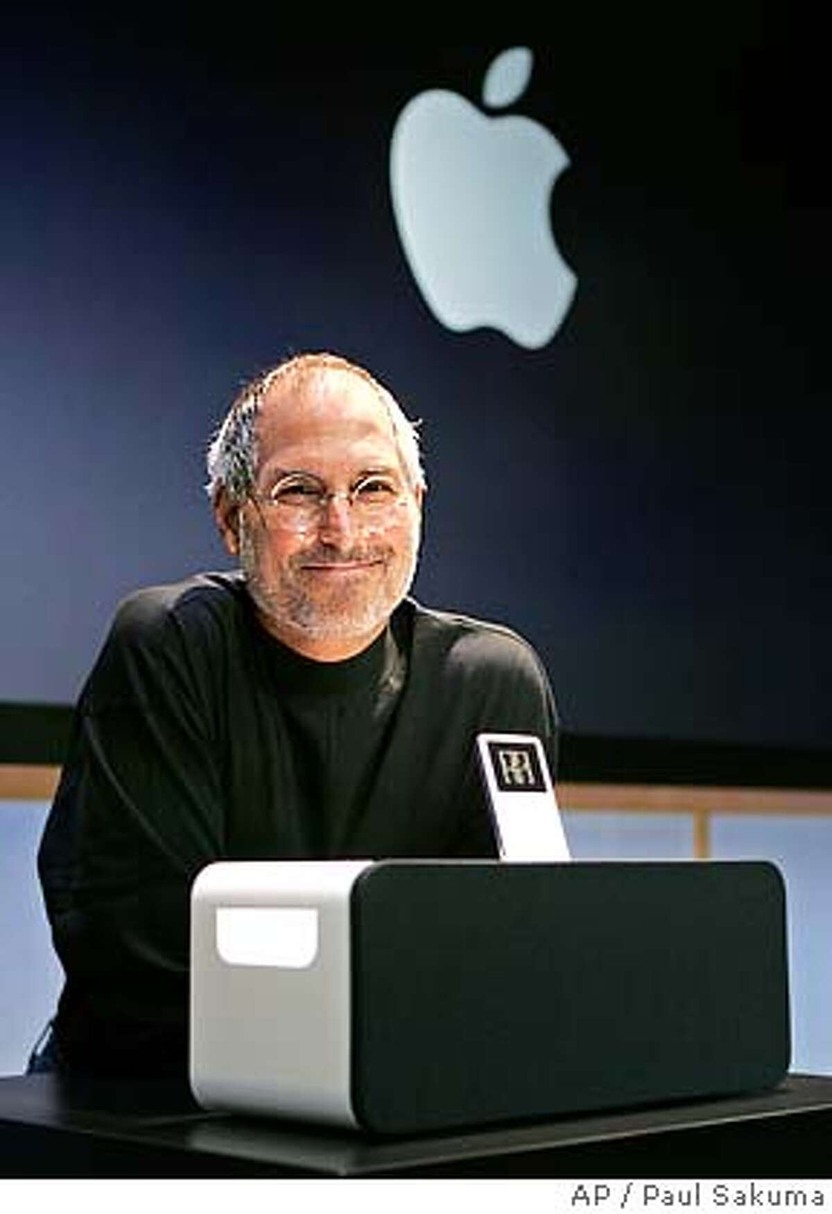 ** ADVANCE FOR SUNDAY MARCH 26 **FILE**Apple Computer Inc. CEO Steve Jobs smiles next to the new Apple iPod Hi-Fi speaker system for its iPod player at an unveiling at Apple headquarters in Cupertino, Calif., Tuesday, Feb. 28, 2006. As the storied company celebrates its 30th birthday in a week, Apple Computer Inc. will be showing its age: It will have brushed off its bruises from product failures and arguably misguided decisions to emerge with a shine that's more than skin-deep. Its luster now is brighter than ever, but for all of its recent successes, Apple also has its share of challenges ahead as it matures into a digital media provider. (AP Photo/Paul Sakuma)Ran on: 03-28-2006 Apple chief Steve Jobs has uncanny similarities to a character in his half-sister s new book, A Regular Guy. Ran on: 04-21-2006 Why is this man smiling? Steve Jobs computer company will begin a major expansion close to its Cupertino headquarters. Also Ran on: 05-21-2006 ** ADVANCE FOR SUNDAY MARCH 26 **FEB 28 2006 FILE PHOTO