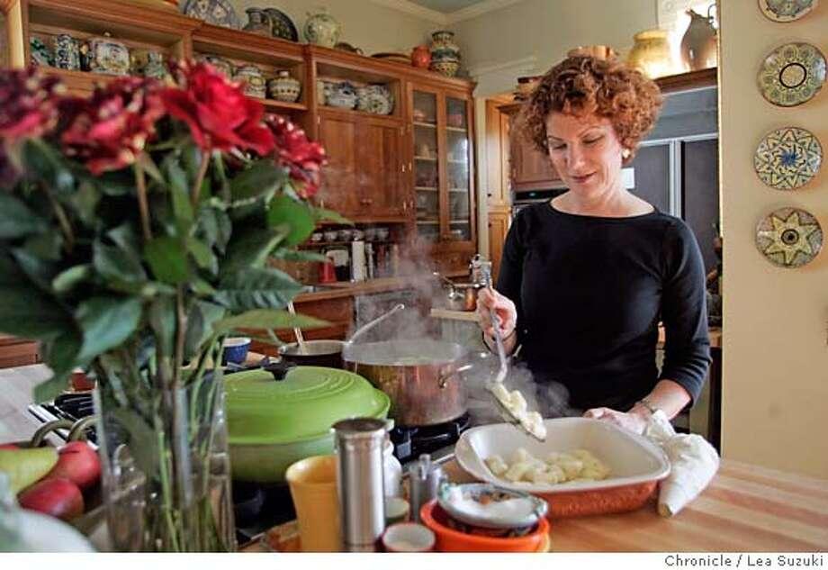 chef13_099_ls.JPG  Cookbook author Joanne Weir prepares Gnocchi with Roquefort Cream on Wednesday, December 6, 2006. Photo by Lea Suzuki/The San Francisco Chronicle  Photo taken on 12/6/06, in San Francisco, CA. **(themselves) cq. Ran on: 12-27-2006  Cookbook author Joanne Weir prepares Gnocchi with Roquefort Cream in her kitchen. Photo: Lea Suzuki