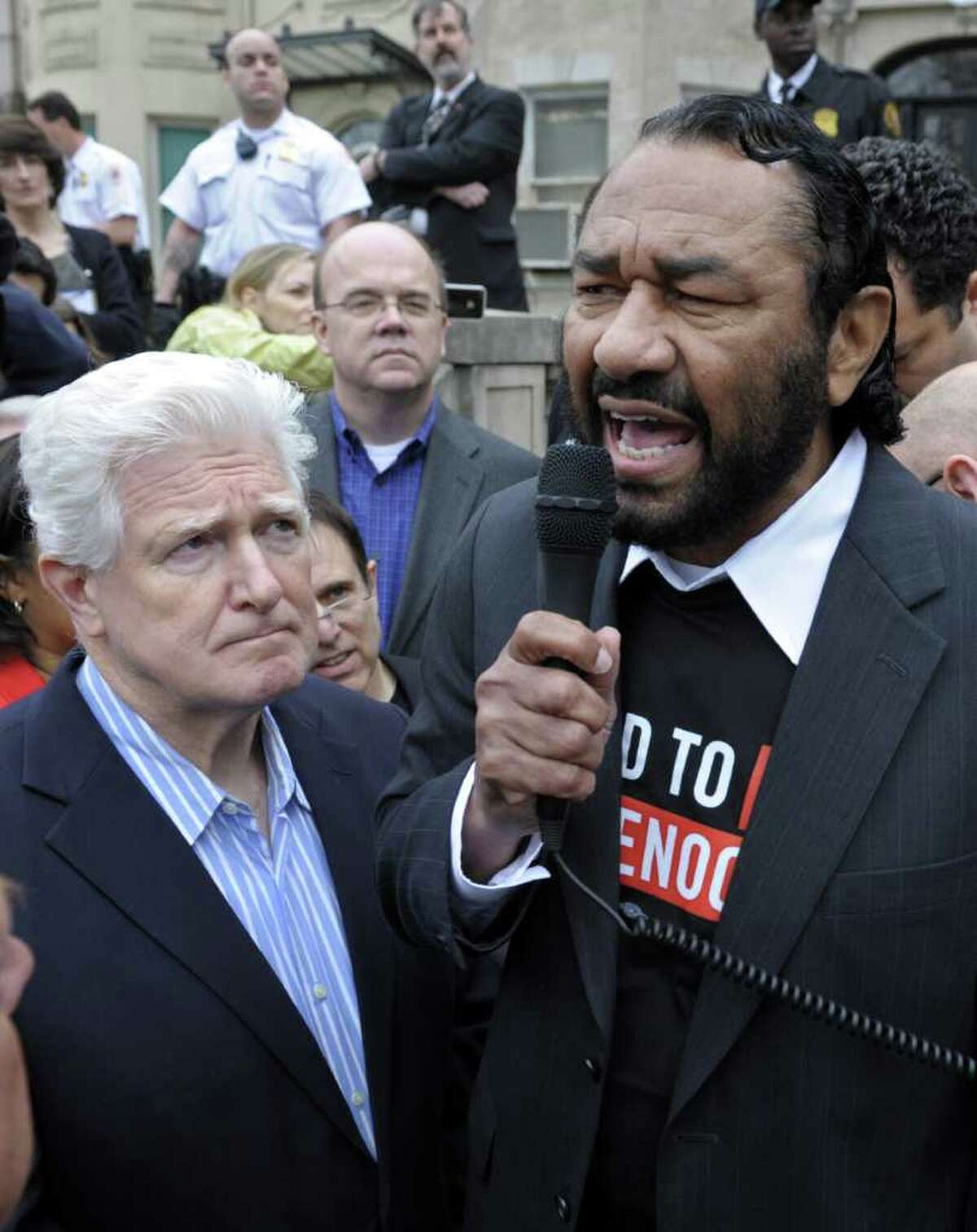 Rep. Jim Moran, D-Va. looks at left, as Rep. Al Green, D-Texas speaks during a protest at the Sudan Embassy in Washington, Friday, March 16, 2012. The demonstrators are protesting the escalating humanitarian emergency in Sudan that threatens the lives of 500,000 people. Rep. Jim McGovern, D-Mass. is at center.