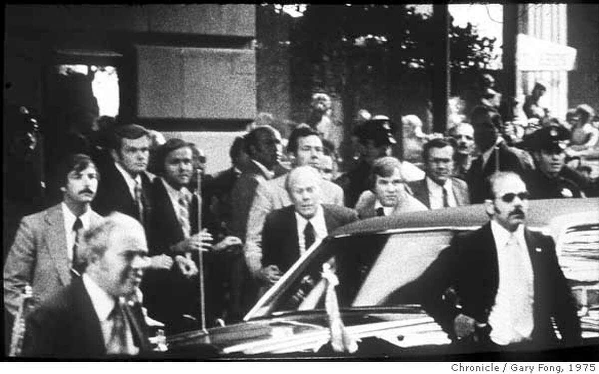 Pres. Gerald Ford Assination Attempt by Sarah Jane Moore at the St. Francis Hotel, Post St. entrance. Secret Service Agents hear a shot and grab Pres. Ford to push him in the armor protected limo. Photo by Gary Fong