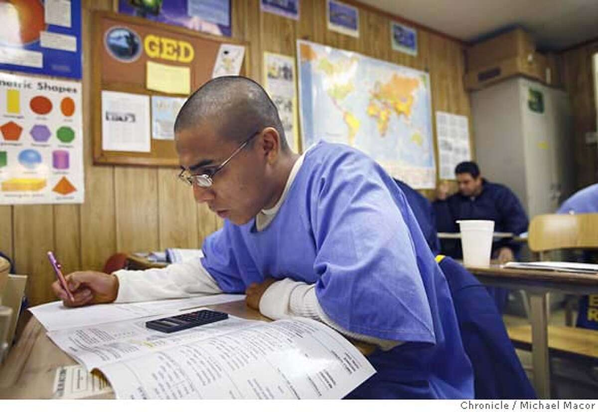 prisoneducation_024_mac.jpg Inmate Gabriel Velasquez is taking his pre GED math class, Velasquez is enrolled in the AB-2 (Adult Basic Education) class. AB-2 is the upper level course. CRC-California Rehabilitation Center in Norco, Ca. Nearly everyone agrees that the best way to address the overcrowding in California's prisons is to reduce the soaring recidivism rate, and that one of the best ways to get the rate down is to arm the more than 100,00 inmates who are functionally illiterate with a solid education. Educations programs in the prisons are badly underfunded and serve few of the inmates needing help. Too few classrooms,long waiting lists for getting into remedial programs. Event in, Norco, Ca, on 12/20/06. Photo by: Michael Macor/ San Francisco Chronicle Mandatory credit for Photographer and San Francisco Chronicle / Magazines Out