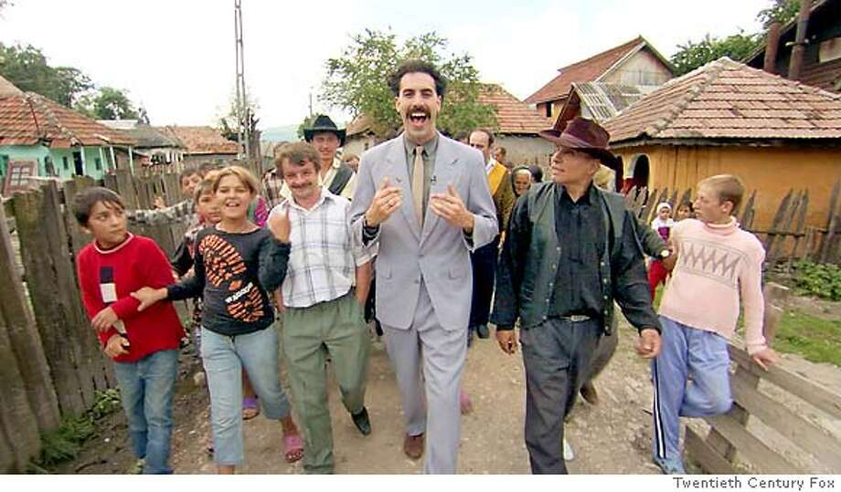 """�Sacha Baron Cohen, starring as the title character in """"Borat,"""" is a Kazakhstani reporter who leaves his homeland to make a documentary in America. The movie opens Friday in Bay Area theaters. Credit: Twentieth Century Fox Ran on: 10-29-2006 Sacha Baron Cohen (center), starring as the title character in &quo;Borat,&quo; is a Kazakhstani reporter who leaves his homeland to make a documentary in America. The movie opens Friday. (Multiple values)"""