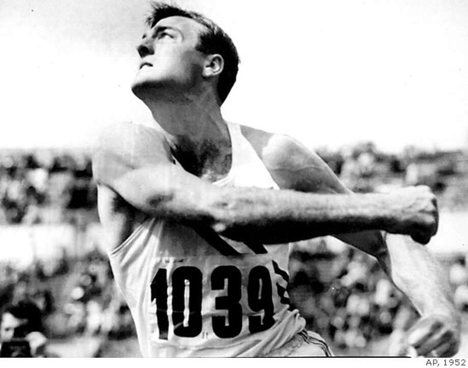 ** FILE ** Bob Mathias, of Tulare, Calif., defending Olympic decathalon champion, heaves the discus in Helsinki, Finland, in this July 26, 1952 file photo, to add to his lead in the decathalon. Mathias, a two-time Olympic champion in the decathlon and former U.S. congressman, died Saturday, Sept. 2, 2006. He was 75. The U.S. Olympic Committee said in a statement that Mathias died in his home. A cause of death wasn't released. (AP Photo, file) Photo: AP