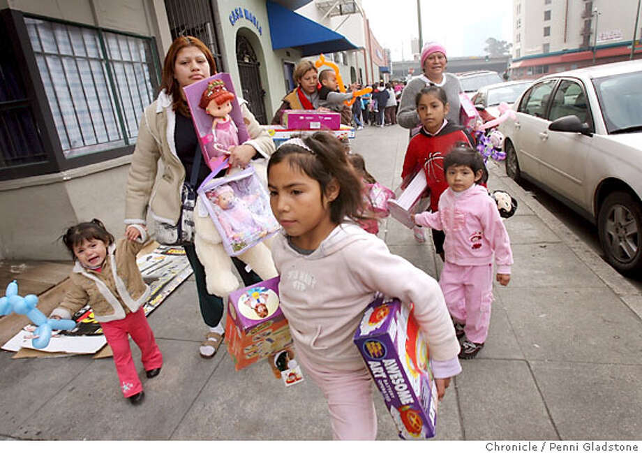 Children carry gifts from the Free Dining Room in Oakland. Chronicle photo by Penni Gladstone