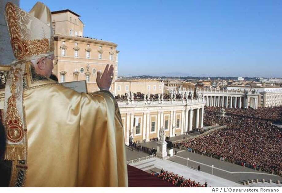 In this photo released by the Vatican's L'Osservatore Romano newspaper, Pope Benedict XVI blesses the faithful gathered in St. Peter's Basilica at the Vatican for the ''Urbi et Orbi'' address, Latin for ''To The City and To The World,'' Monday, Dec. 25, 2006. The pontiff urged a solution to conflicts across the world, especially in the Middle East and Africa, in a Christmas Day address that included an appeal for the poor, the exploited and all those who suffer. (AP Photo/L'Osservatore Romano) Photo: ARTURO MARI
