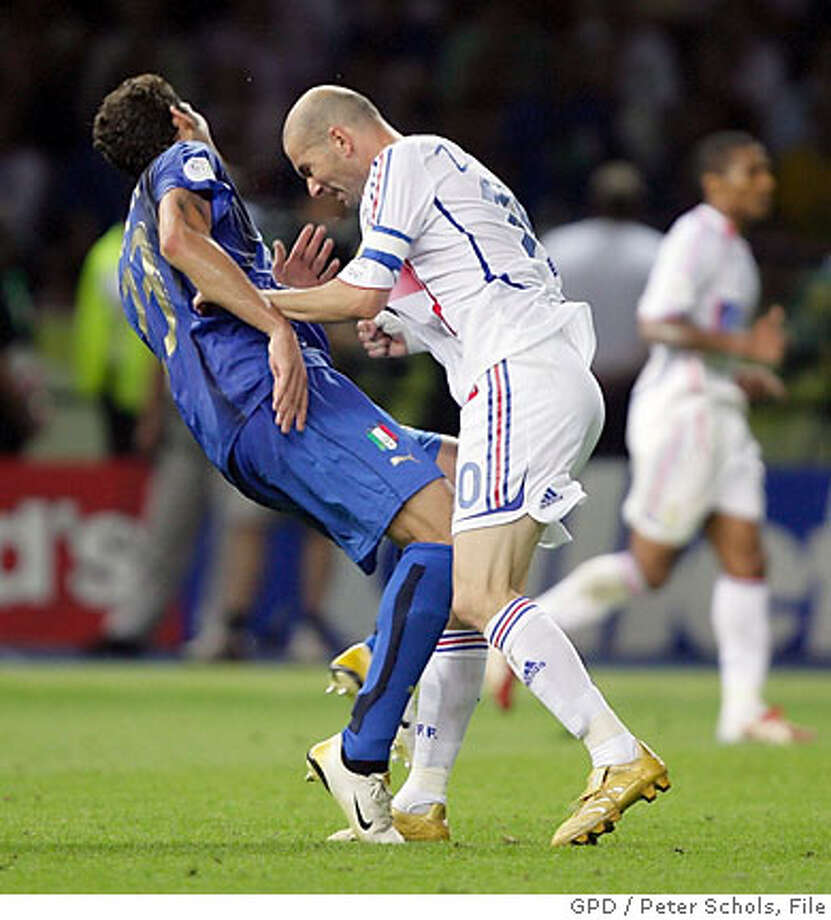PICTURES OF THE YEAR 2006  Italy's Marco Materazzi falls on the pitch after being head-butted by France's Zinedine Zidane (R) during their World Cup 2006 final soccer match in Berlin July 9, 2006. FIFA RESTRICTION - NO MOBILE USE HOLLAND OUT Picture taken July 9, 2006. REUTERS/Peter Schols/GPD/Handout Photo: HO