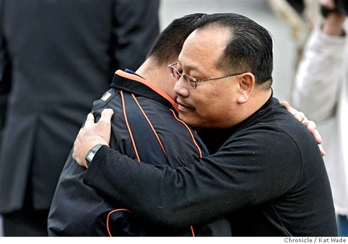 TUVERA_0049_KW_.jpg (RIGHT TO LEFT) Officer Craig Tom (CQ) who was Tuvera's field training officer, hugs another officer (who would not give his name) after a press conference was held on Christmas Eve December 24, 2006 at the Taraval San Francisco Police Station to honor Officer Bryan Tuvera, 28, who was fatally wounded Friday night in the line of duty attempting to serve a warrant on escaped prisoner, Marlon Ruff, 33, Kat Wade/The Chronicle
