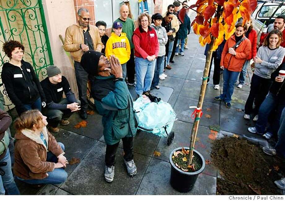 A neighborhood resident blows a kiss to a tree about to be planted by volunteers of the Friends of the Urban Forest that planted 30 trees in the Tenderloin neighborhood in San Francisco, Calif. on Saturday, Dec. 9, 2006.  PAUL CHINN/The Chronicle MANDATORY CREDIT FOR PHOTOGRAPHER AND S.F. CHRONICLE/ - MAGS OUT Photo: PAUL CHINN