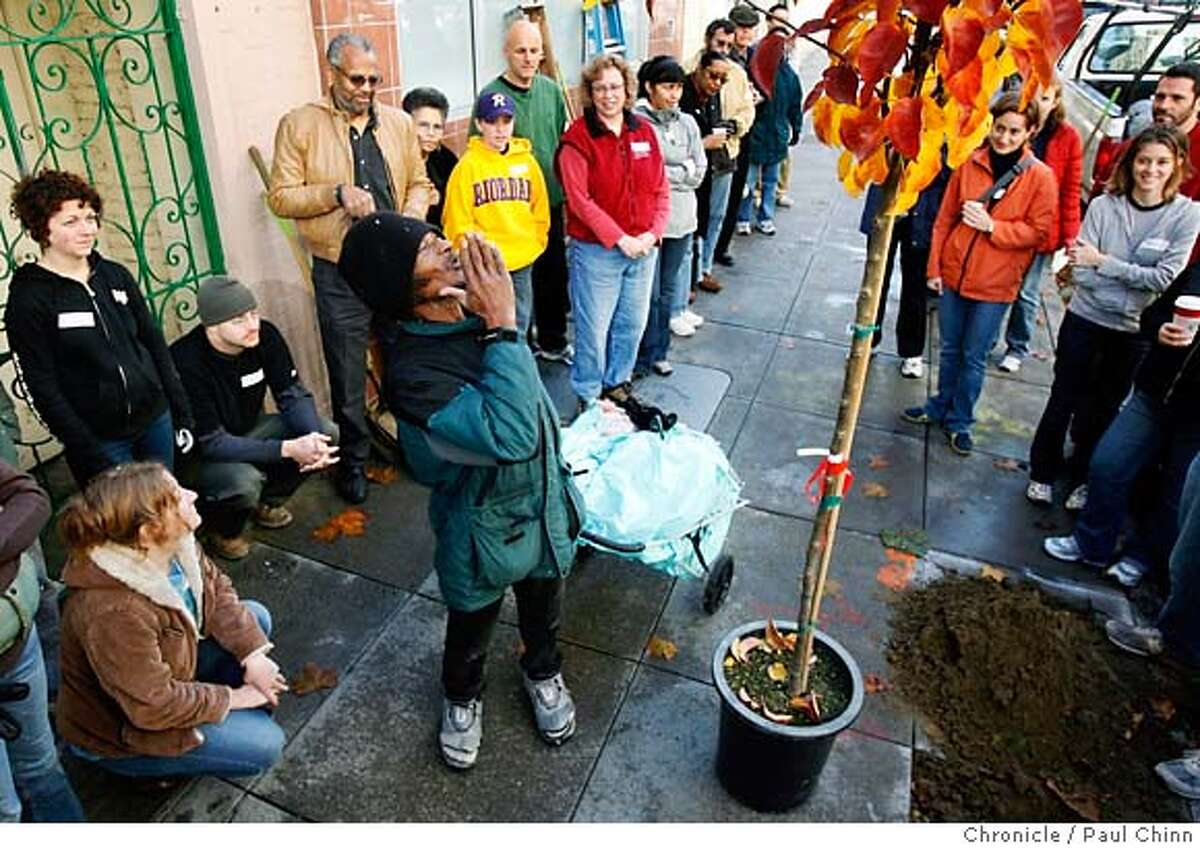 A neighborhood resident blows a kiss to a tree about to be planted by volunteers of the Friends of the Urban Forest that planted 30 trees in the Tenderloin neighborhood in San Francisco, Calif. on Saturday, Dec. 9, 2006. PAUL CHINN/The Chronicle MANDATORY CREDIT FOR PHOTOGRAPHER AND S.F. CHRONICLE/ - MAGS OUT