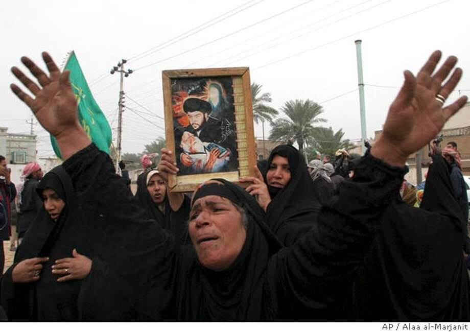 Supporters of the Iraqi radical Shiite cleric Muqtada al-Sadr gather outside his house in Najaf, 160 kilometers (100 miles) south of Baghdad, Iraq, Saturday, Dec. 23, 2006, during his meeting with a delegation from the United Iraqi Alliance, the Shiite coalition that dominates the Iraqi parliament. The Shiite delegation met with al-Sadr and Iraq's most revered Shiite cleric Grand Ayatollah Ali al-Sistani in Najaf over the past few days in order to try and rebuild the Shiite coalition in parliament. (AP Photo/Alaa al-Marjani) Photo: ALAA AL-MARJANI