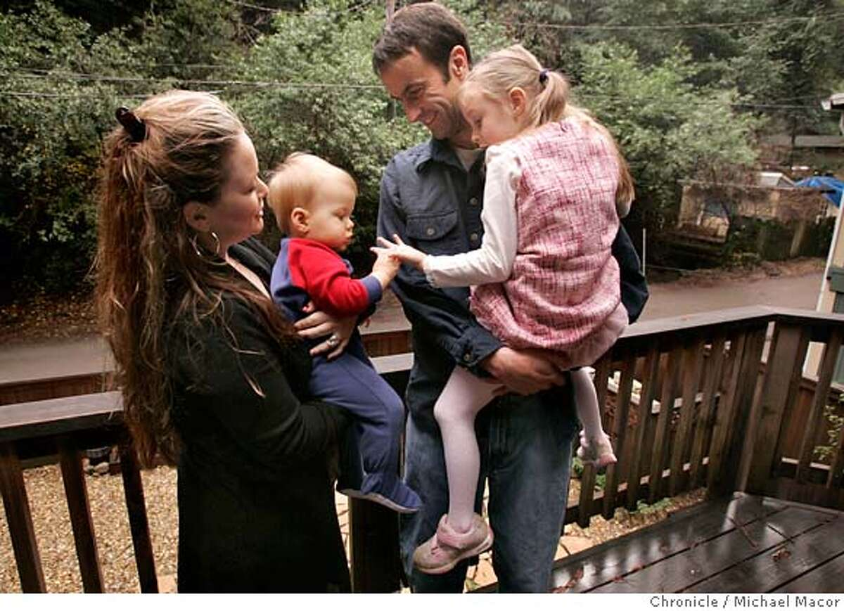 Fraley with his famiily at their Guerneville home, wife Shannen, son Aiden,1 and daughter Alana, 5. Survivor of last week's shark attack near Dillon Beach. Royce Fraley, his wife Shannen, and two young children at their home in Guerneville. The longtime surfer owns about 20 boards, but hasn't yet returned to the water since his close encounter.. Event in, Guerneville, Ca, on 12/23/06. Photo by: Michael Macor/ San Francisco Chronicle