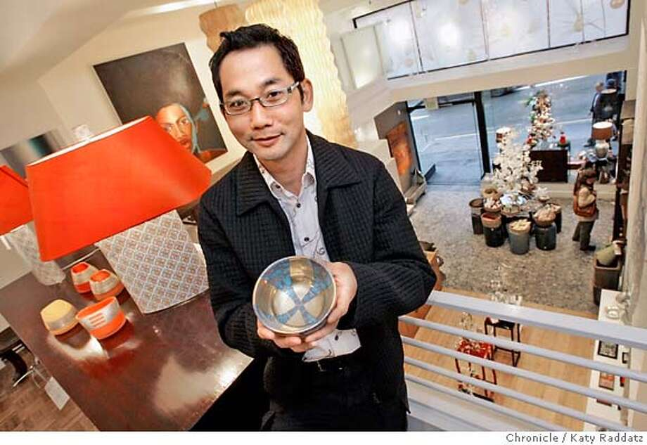 ONTHETOWN_LUM_006_RAD.jpg  SHOWN: John Lum, an architect, in one of his favorite places: The Big Pagoda Store at 310 Sutter St. in San Francisco. Mr. Lum holds a porcelain, gold finish, lusterware bowl made by Michael Wainwright of the U.S.A. The store is full of lovely well-designed objects, some old, some new. These photos were made on Tuesday, Dec. 12, 2006, in San Francisco, CA.  (Katy Raddatz/SF Chronicle)  * John Lum Mandatory credit for the photographer and the San Francisco Chronicle. ; mags out. Photo: Katy Raddatz