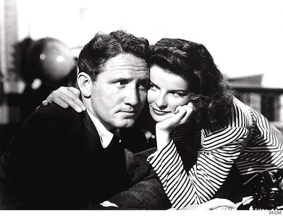 "ADVANCE FOR WEEKEND, MARCH 30-APRIL 2--FILE--Actress Katharine Hepburn and co-star Spencer Tracy appear in a scene from the 1942 MGM film, ""Woman of the Year."" A two-time Academy Award winner who died in 1967, Tracy would have been 100 this spring. (AP Photo/MGM) CAT Photo: Ho"