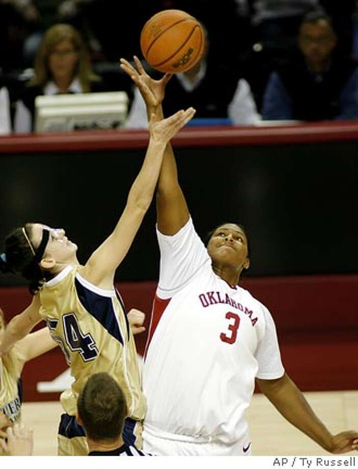 Oklahoma center Courtney Paris (3) and Northern Colorado center Tina Fox (54) reach for the ball in the first half of an NCAA basketball game Sunday, Dec. 17, 2006, in Norman, Okla. (AP Photo/Ty Russell) Photo: TY RUSSELL