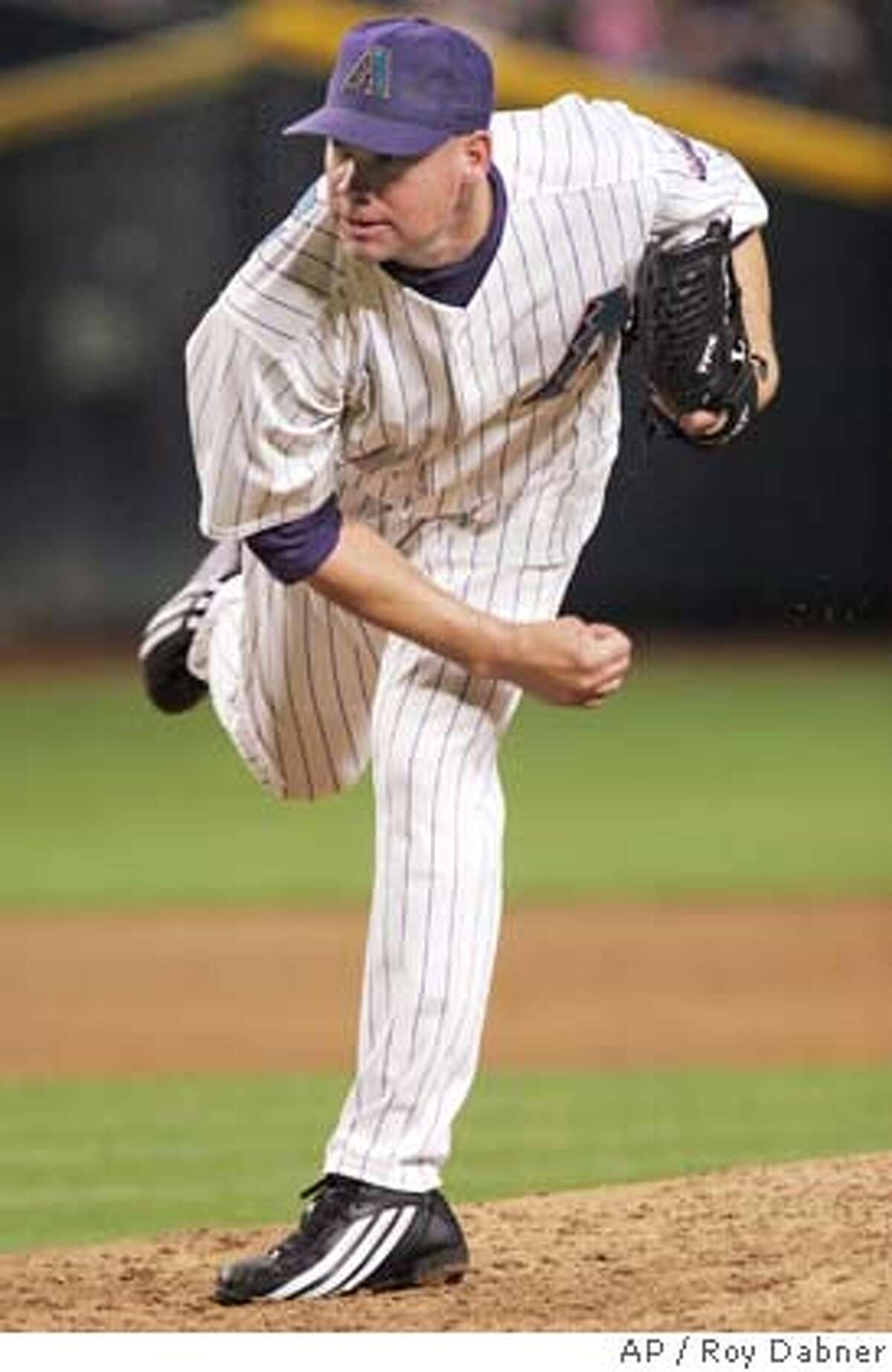 Jason Grimsley follows through on a pitch during a game in Phoenix last month. Associated Press photo by Roy Dabner