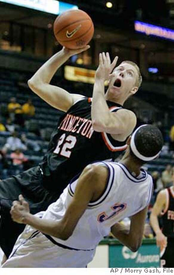 Princeton's Lincoln Gunn (22) is called for a charge as he runs into Northwestern State's Trey Gilder (3) during the second half of the consolation game at the Blue and Gold Classic college basketball tournament Saturday, Dec. 2, 2006, in Milwaukee. (AP Photo/Morry Gash) EFE OUT Photo: MORRY GASH
