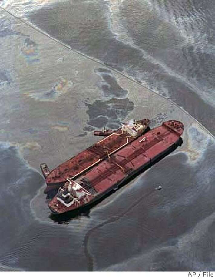 **FILE** The Exxon Baton Rouge, smaller ship, attempts to off load crude oil in a March 26,1989 file photo, from the Exxon Valdezafter the Exxon Valdez ran aground in the Prince William sound, spilling more than 270,000 barrels of crude oil. A federal appeals court on Friday, Dec. 22, 2006, cut in half a $5 billion jury award for punitive damages against Exxon Mobil Corp. in the 1989 Valdez oil spill that smeared black goo across roughly 1,500 miles of Alaskan coastline. (AP Photo, File) A MARCH 26,1989 FILE PHOTO Photo: X