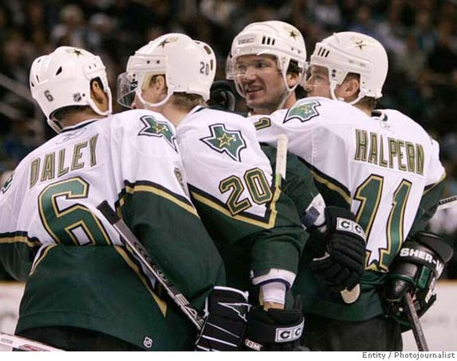 Dallas Stars' Jeff Halpern, right, is congratulated by teammates including Trevor Daley (6) and Antti Miettinen (20) after scoring a goal against the San Jose Sharks' in the first period of an NHL hockey game Thursday, Dec. 21, 2006, in San Jose, Calif. (AP Photo/Ben Margot) Photo: Ben Margot