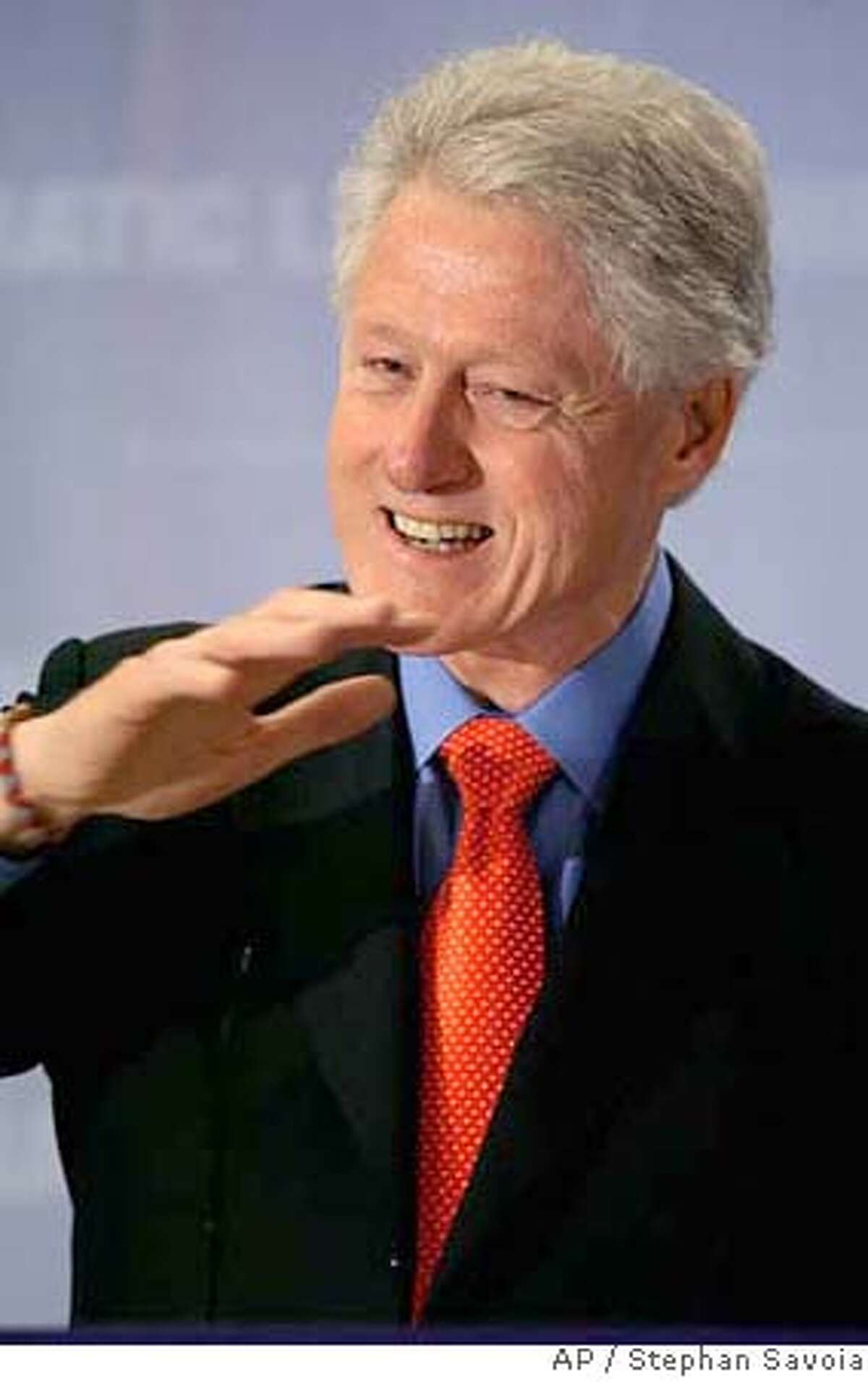 Former U.S. President Bill Clinton addresses a Democratic Leadership Council luncheon before presenting the DLC Clinton Center Award for 2006 to recipients in Cambridge, Mass., Thursday, Dec. 14, 2006. (AP Photo/Stephan Savoia) STAND ALONE PHOTO