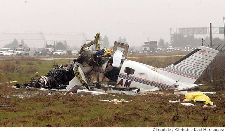 Photo of destroyed airplane, with dead body under yellow tarp, bottom right, hwy.4 behind.. Small aircraft leaving Buchanan airport in Concord, crashes at hwy. 4, killing 3 adults, and leaving a 12 year-old boy in critical condition at hospital.(CHRSTINA KOCI HERNANDEZ/CHRONICLE) Photo: CHRISTINA KOCI HERNANEZ/CHRONICL