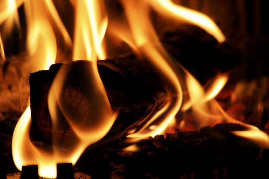 image for yule log on tv story. burning fire fireplace firewood log Photo: Ho