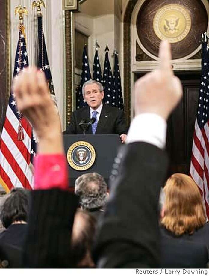 U.S. President George W. Bush holds his traditional year-end news conference in the Indian Treaty Room of the Eisenhower Executive Office Building at the White House complex in Washington December 20, 2006. REUTERS/Larry Downing (UNITED STATES)  Ran on: 12-21-2006  President Bush holds his year-end news conference in the Indian Treaty Room of the Eisenhower Executive Office Building in Washington. He was guarded when asked about a troop 'surge.' Photo: LARRY DOWNING
