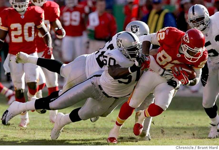 raiders027_ward.jpg  The Chiefs Dante Hall had a mess of Raiders all over him after a reception in the second half.  Oakland Raiders vs. Kansas City Chiefs at Arrowhead Stadium.The Chiefs won in the final moments of the game on a touchdown by Larry Johnson 27-23.  11/6/05 Photo: Brant Ward