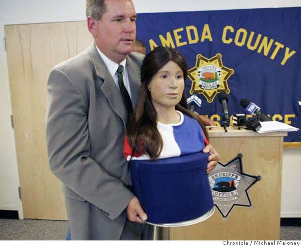 JANEDOE18_122_MJM.jpg Alameda County Sheriff's Sergeant Scott Dudek moves the bust of Jane Doe created by scientific and forensic artist Gloria Nusse. Hoping to jumpstart the stalled investigation into the death of an unidentified teen found in a duffel bag behind a Carrow's restaurant in Castro Valley, the Alameda County Sheriff�s Office held a press conference to unveil a three-dimensional likeness of the girl, known only as Jane Doe. The bust was created by a forensic anthroplogist after the girl's body was exhumed in June. Investigators have combed the state and even gone to Mexico in an fruitless effort to identify the girl and, possibly, her killer. Photo by Michael Maloney / San Francisco Chronicle MANDATORY CREDIT FOR PHOTOG AND SF CHRONICLE/ -MAGS OUT