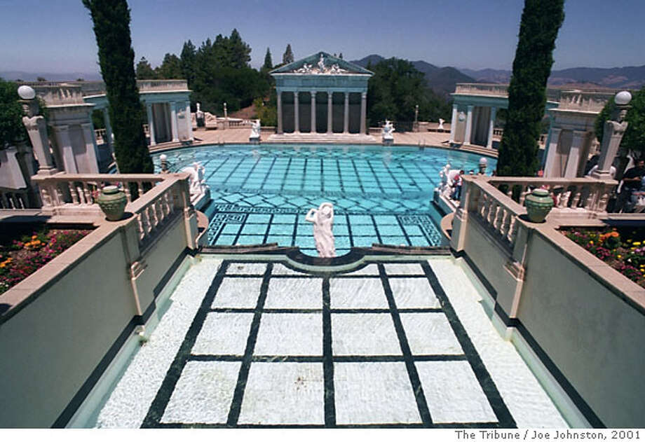 FILE--The swimming pool at Hearst Castle is shown in this file photo from July 8, 2001, in San Simeon, Calif. Evening tours of the castle, instituted a dozen years ago but offered only during slack tourist periods, have been extremely popular, according to a spokesman for the state park system, which administers the property. (AP Photo/The Tribune, Joe Johnston, File) Ran on: 06-23-2004  What makes Hearst Castle enchanting, besides the grand, sweeping pool and architecture, are the many thoughtful details. Ran on: 06-23-2004 Ran on: 06-23-2004 Ran on: 06-23-2004 Ran on: 06-23-2004 Ran on: 12-25-2005  Orcas play in the waters off of Vancouver Island in British Columbia, one of several scenic Canadian locales with lodgings recommended by Chronicle readers. Photo: JOE JOHNSTON