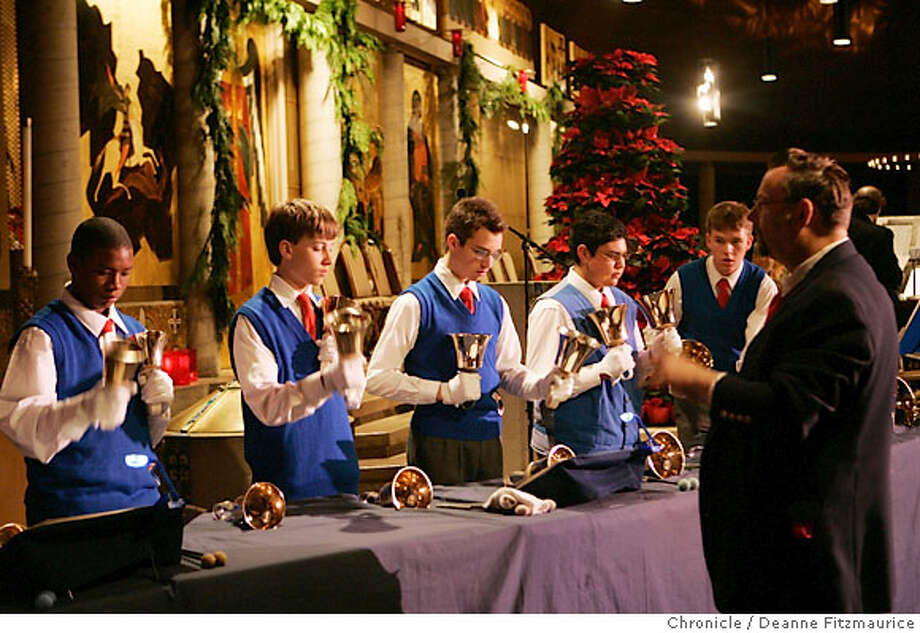 "soundscene21_0211_df.jpg  Steven Meyer (at right) directs the performance. The Ringmasters perform at the annual concert, ""An International Christmas"" at Ascension Cathedral. Photographed in Castro Valley on 12/8/06. (Deanne Fitzmaurice/ The Chronicle) Photo: Deanne Fitzmaurice"