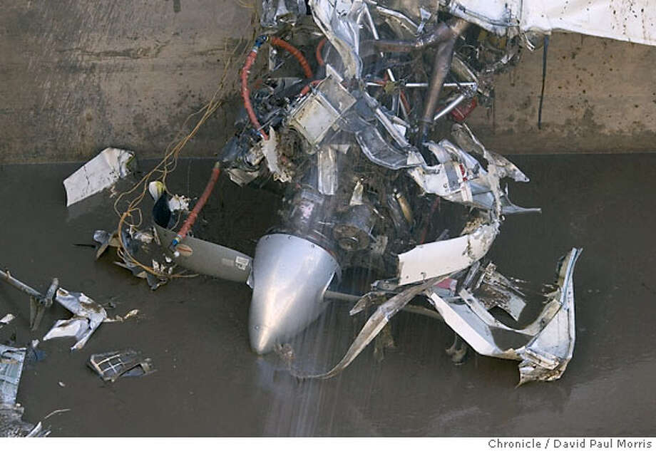 GILROY, CA- DECEMBER 19: One of the props lies at the bottom of a sewage tank as workers work to clean up the debris of a twin-engine Beechcraft Travel Air after it crashed into a tank of raw sewage at the South County Regional Wastewater Authority treatment plant in on December 18, 2006 in Gilroy, California. On board the plane was the flight instructor, Shoki Haraguchi and the passengers, Yoshiyuki Kato and Yasushi Miyata, who had come to the United States to learn how to fly. (Photo by David Paul Morris/The Chronicle) Photo: David Paul Morris