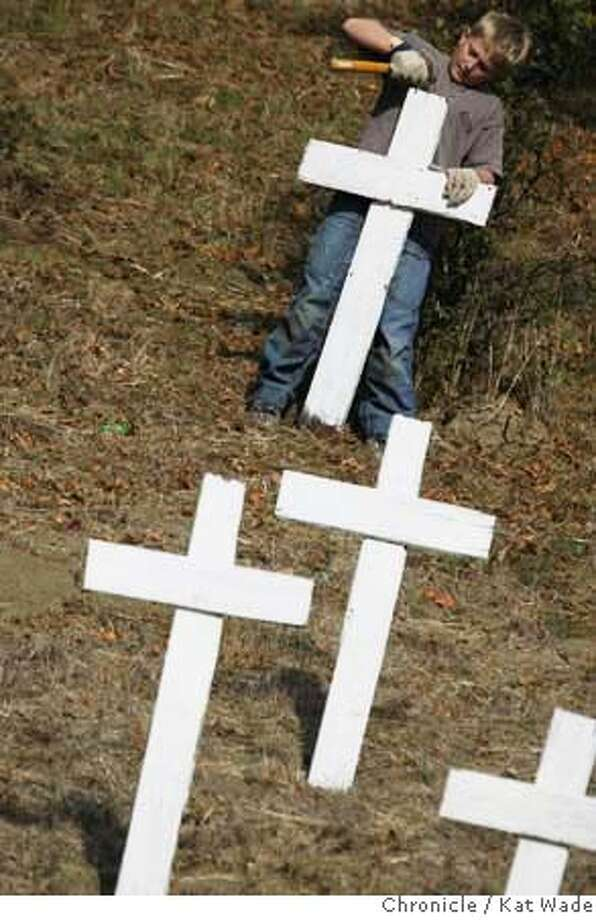 "CROSSES13_0055_KW_.jpg  On Sunday November 12, 2006 Sam Anderson, 10, jopined members of Mt. Diablo Peace Center, Rossmoor's Grandparents for Peace, the Lamorinda Peace and Justice Group and even some passerby's to plant some 300 crosses as part of the ""Crosses of Lafayette"" project created by Lafayette resident Jeff Heaton to remind people of the troops that have died in the Iraq conflict. Kat Wade/The Chronicle Mandatory Credit for San Francisco Chronicle and photographer, Kat Wade, Mags out Photo: Kat Wade"