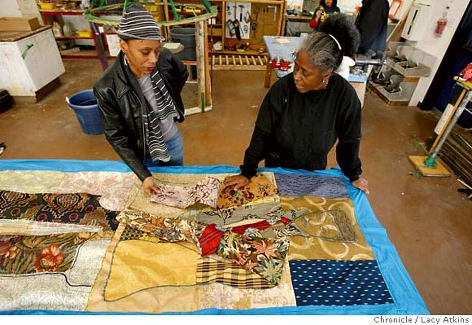 (left to right) Theresa Harris looks over the quilts that Ora Knowell has made, in order to decide that type she is going to have made of her son, Tuesday December 19, 2006, in Oakland, Ca. Harris's son Brian Payne Jr. was killed June of 2005. After Ora Knowell's two sons were killed in Oakland she make quilts for the families of the victims of homicide. December 19, 2006. 2006, in Oakland, (Lacy Atkins/The Chronicle) MANDATORY CREDITFOR PHOTGRAPHER AND SAN FRANCISCO CHRONICLE/ -MAGS OUT Photo: Lacy Atkins