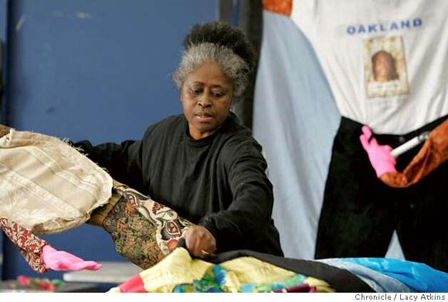 Ora Knowell unfolds the quilts that she has made of victims of homicide, Tuesday december 19, 2006, in Oakland, Ca. After Ora Knowell's two sons were killed in Oakland she make quilts for the families of the victims of homicide. December 19, 2006. 2006, in Oakland, (Lacy Atkins/The Chronicle) MANDATORY CREDITFOR PHOTGRAPHER AND SAN FRANCISCO CHRONICLE/ -MAGS OUT Photo: Lacy Atkins