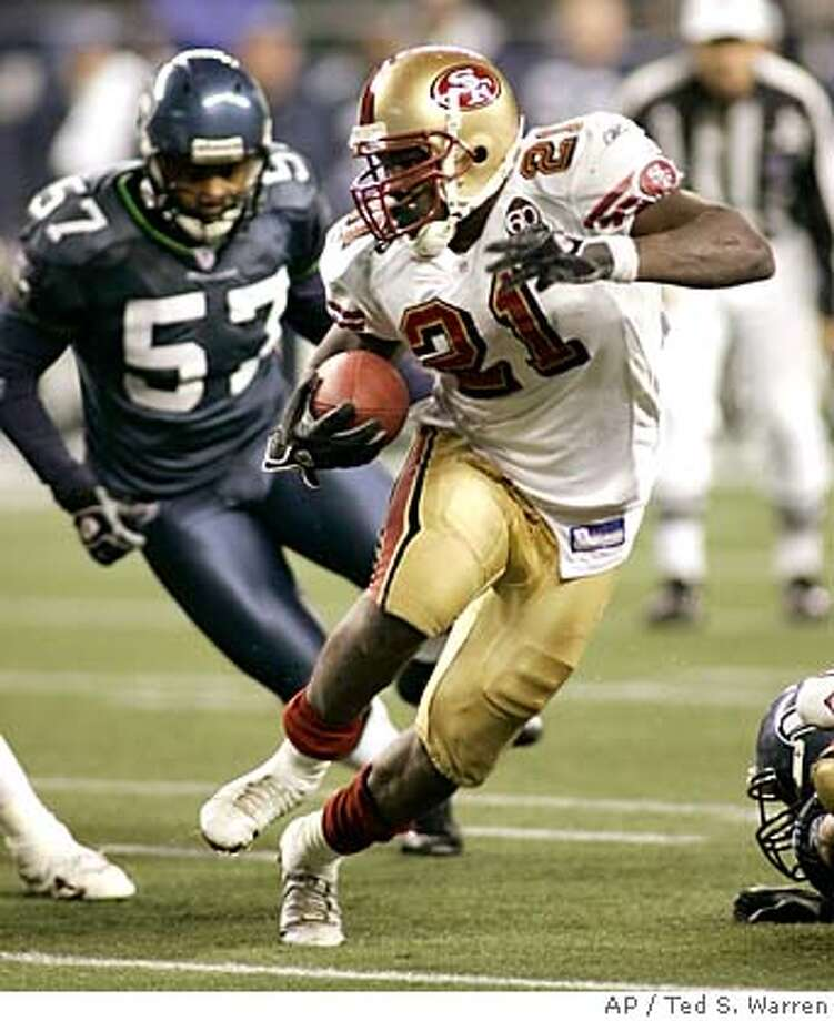 San Francisco 49ers running back Frank Gore (21) rushes as Seattle Seahawks' Kevin Bentley (57) closes in in the fourth quarter Thursday, Dec. 14, 2006, at Qwest Field in Seattle. The 49ers beat the Seahawks, 24-14. (AP Photo/Ted S. Warren) Photo: Ted S. Warren